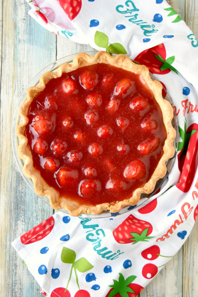 Simply sweet and simply delicious, Fresh trawberry Pie is easy to make and worth every bite.  The fresh strawberries swimming in fresh strawberry jelly are the epitome of spring! #SpringSweetsWeek