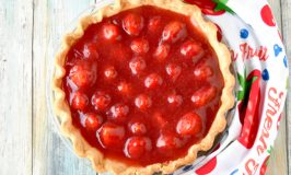 Simply sweet and simply delicious, Strawberry Pie is easy to make and worth every bite.  The fresh strawberries swimming in fresh strawberry jelly are the epitome of spring! #SpringSweetsWeek
