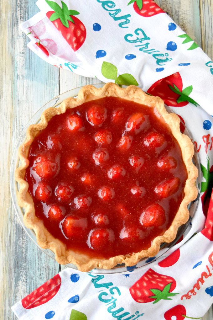 Simply sweet and simply delicious, Fresh Strawberry Pie is easy to make and worth every bite.  The fresh strawberries swimming in fresh strawberry jelly are the epitome of spring! #SpringSweetsWeek