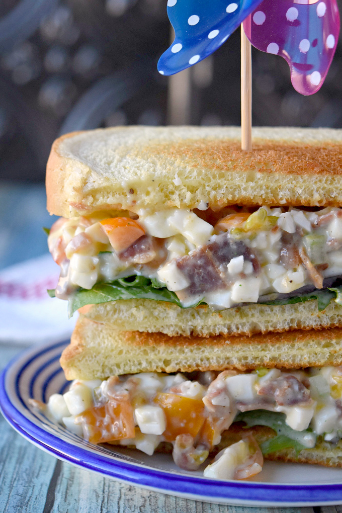 Kick up your egg salad!  BLT Egg Salad Sandwich has bacon and tomato added to the egg salad for added delicious flavor.