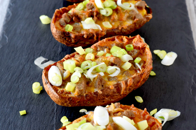 Breakfast Potato Skins have eggs nestled into baked potatoes skins topped with sausage and cheese. They are easy to make ahead and a delicious twist on the classic appetizer! #BrunchWeek
