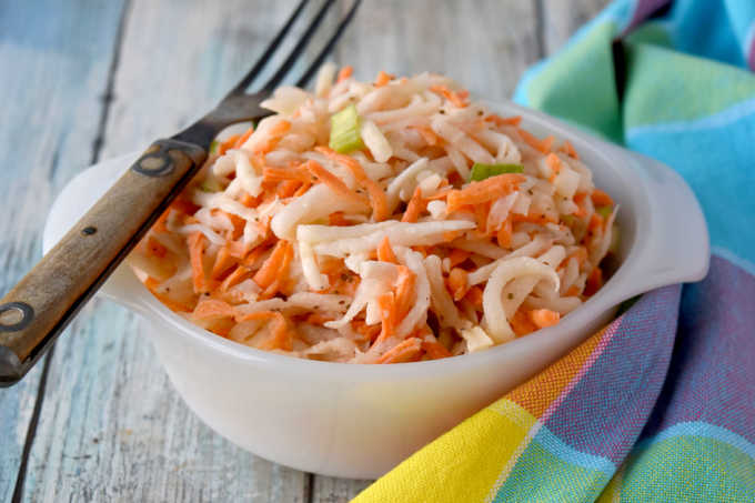 Swap out the cabbage in your slaw and try fresh and delicious kohlrabi. Carrot Kohlrabi Coleslaw is super crunchy, has great flavor, and is the perfect twist on a southern classic picnic dish. #OurFamilyTable