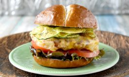 Apple Cheddar Chicken Burgers have apples, onions, ancho chile powder, and buttermilk soaked breadcrumbs. As if that wasn't enough, they're flecked with Cabot extremely sharp Cheddar cheese and topped with zucchini chips, too.