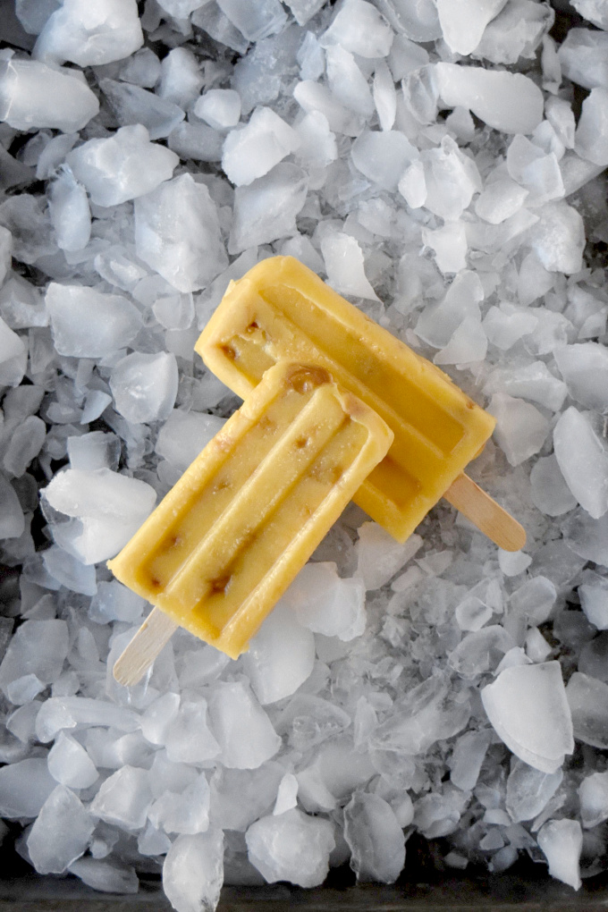 Mango Macadamia Nut Popsicles have sweet mango, creamy yogurt, mango juice, and exotic macadamia nuts. They whip up in no time and taste oh so delicious. #Stonefruit