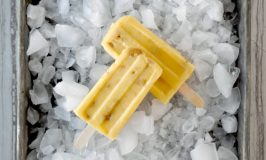 Mango Macadamia Popsicles have sweet mango, creamy yogurt, mango juice, and exotic macadamia nuts. They whip up in no time and taste oh so delicious. #Stonefruit