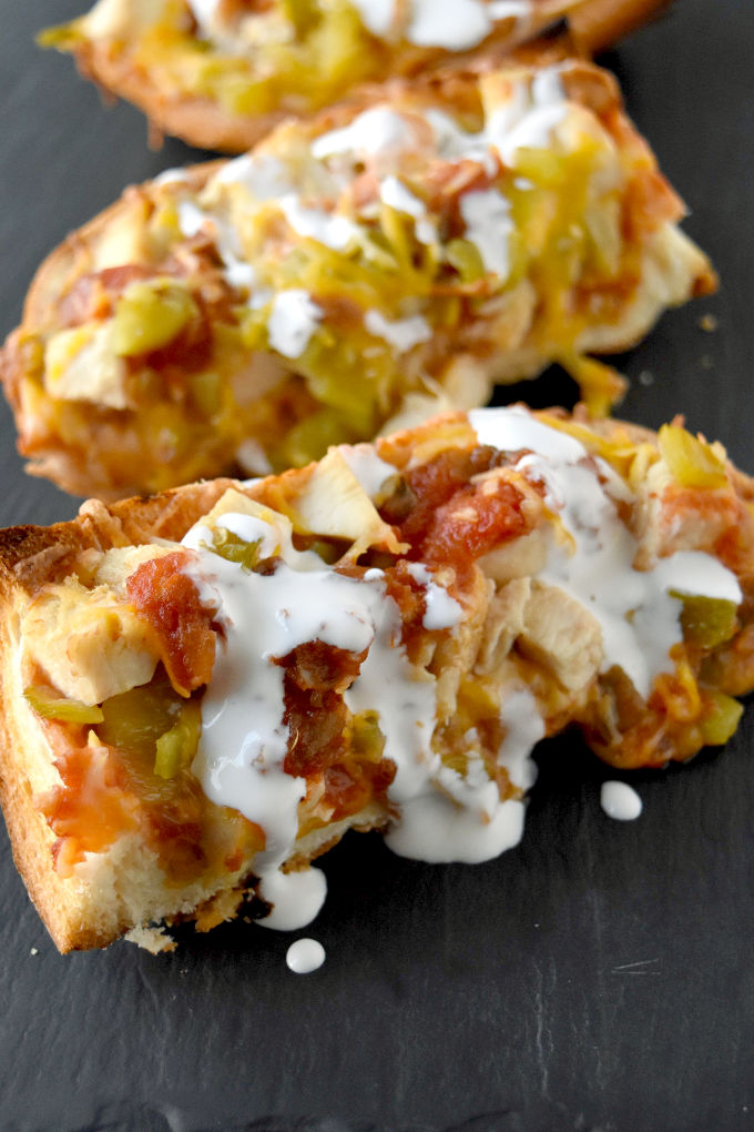 Rotisserie chicken, salsa, cheese, and a loaf of French bread make a quick and easy Chicken Taco French Bread Pizza. It's on the table in under 30 for a fast and family friendly dinner. #OurFamilyTable