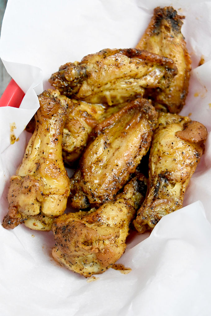 Crispy Lemon Pepper Wings have that slightly tart and peppery taste you'd expect from lemon pepper.  Made in the air fryer, they're super easy, crispy and low maintenance for your game day. #OurFamilyTable