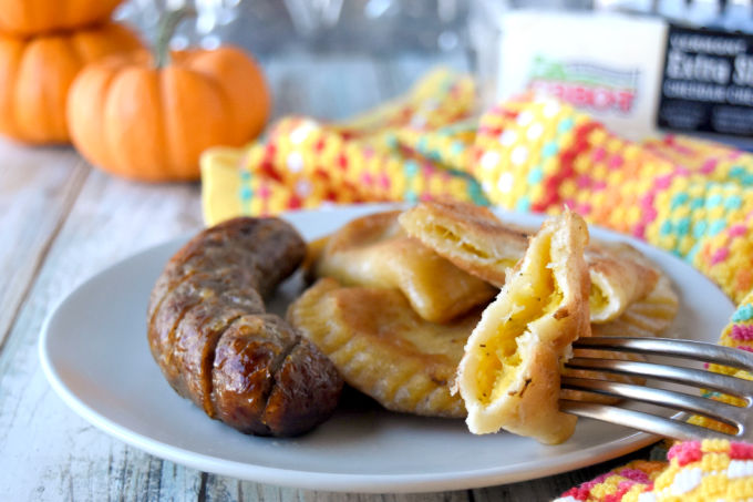 These Pumpkin Cheddar Pierogies are tender homemade dumplings are filled with freshly roasted pumpkin and seriously sharp Cabot cheese. The slightly sweet pumpkin is the perfect pair with sharp cheddar cheese. #PumpkinWeek