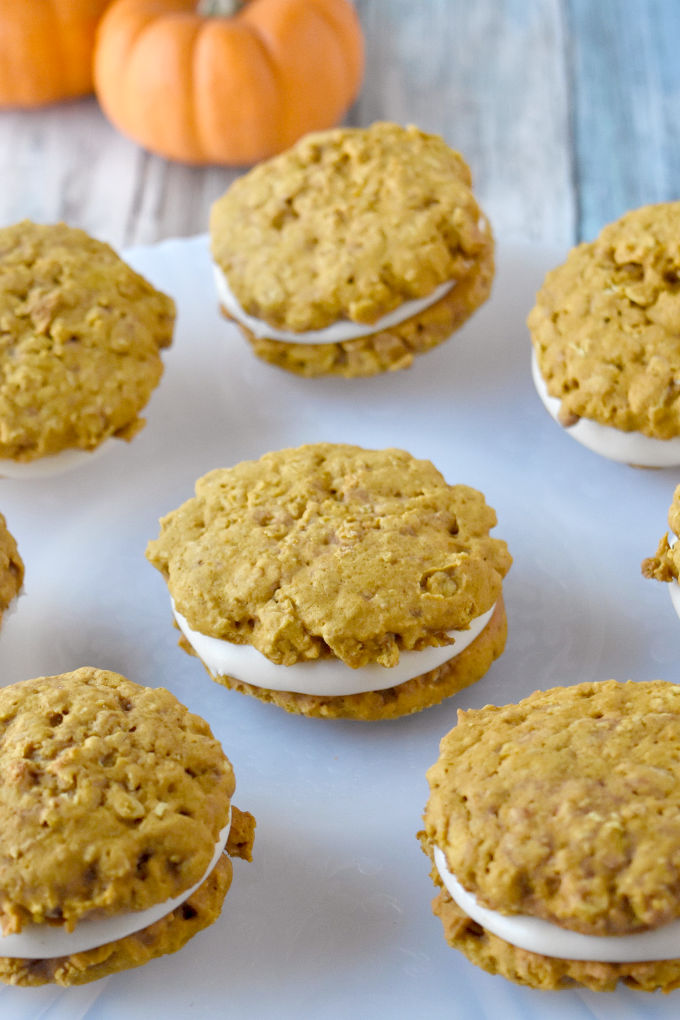 Pumpkin Oatmeal Cream Pies have that oatmeal cream pie flavor with a hint of pumpkin and spices throughout. They're soft, chewy, and totally irresistible.