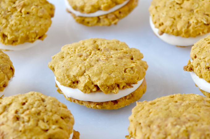 Pumpkin Oatmeal Cream Pies have that oatmeal cream pie flavor with a hint of pumpkin and spices throughout. They're soft, chewy, and totally irresistible. #PumpkinWeek