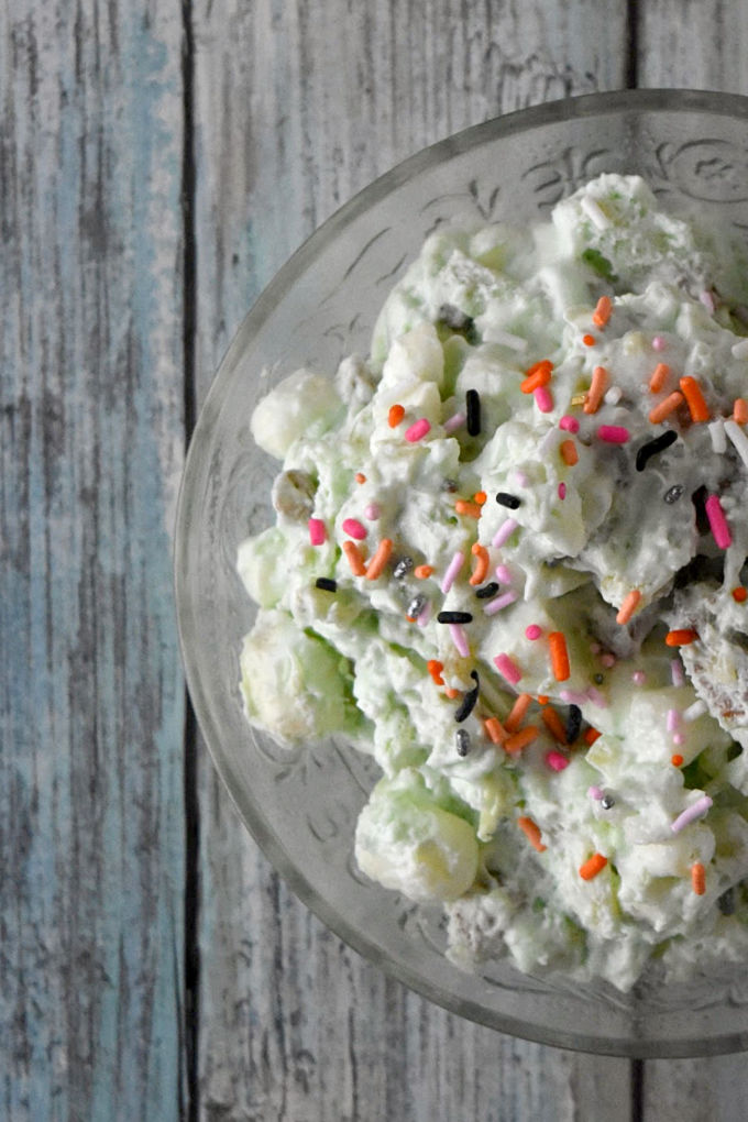This Ectoplasm Fluff Salad isn't slimy it at all!  In fact, it's packed with delicious pistachio pudding, pineapple, and marshmallows for a fun and delicious Halloween treat. #HalloweenTreatsWeek