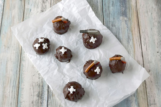 Oozing Caramel Truffles have a sweet and creamy caramel center encased in rich, delicious chocolate truffle. The caramel oozes out as soon as you bite into the dark truffle making them perfectly delicious. #HalloweenTreatseWeek