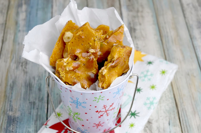 With just a handful of ingredients and a few minutes in the microwave, this Easy Nut Brittle is a last minute time saver for surprise guests or gifts. #ChristmasSweetsWeek