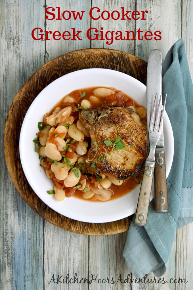 Giant lima beans in tomato broth of pan search bone-in pork chop