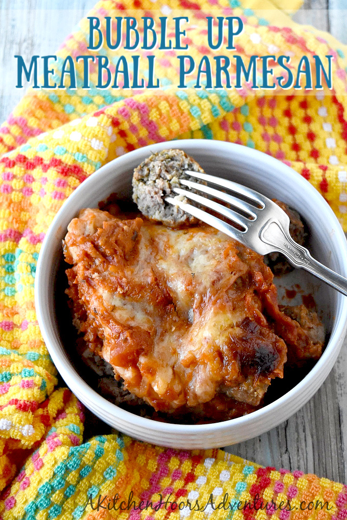 Bubble Up Meatball Parmesan has a biscuit base, Italian meatballs, marinara, and delicious cheese.  It's a fun, family friendly recipe that you can whip up easily.