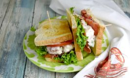 Lobster Roll BLT is a delicious mash up of both sandwiches! Broiled lobster is tossed with mayonnaise, lemon juice, and green onions and tops lettuce and tomato before being topped with bacon. It's a deliciously smoky and sweet sandwich that is irresistible.