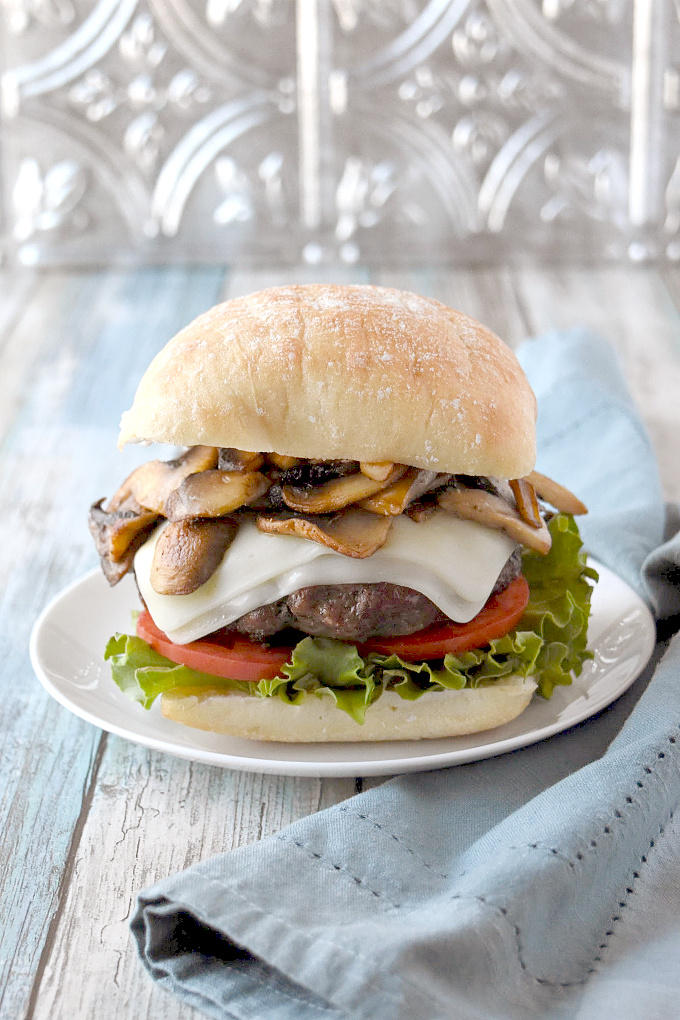 Inspired by the Shake Shack mushroom burger, this Mozzarella Stuffed Mushroom Burger is moist, delicious, and stuffed with the perfect amount of cheese. #BurgerMonth