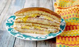 Breakfast Pancake Grilled Cheese skips traditional bread or buns and uses pancakes to hold the fried egg, cheese, and ham together.  It's a fun and delicious breakfast sandwich you can easily make ahead. #OurFamilyTable