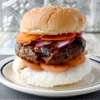 Spicy Bulgogi Burger is packed with garlic and ginger flavor, spicy Korean barbecue sauce, and topped with thinly sliced carrots and radishes.  It's a flavor and texture packed yum on a bun! #BurgerMonth