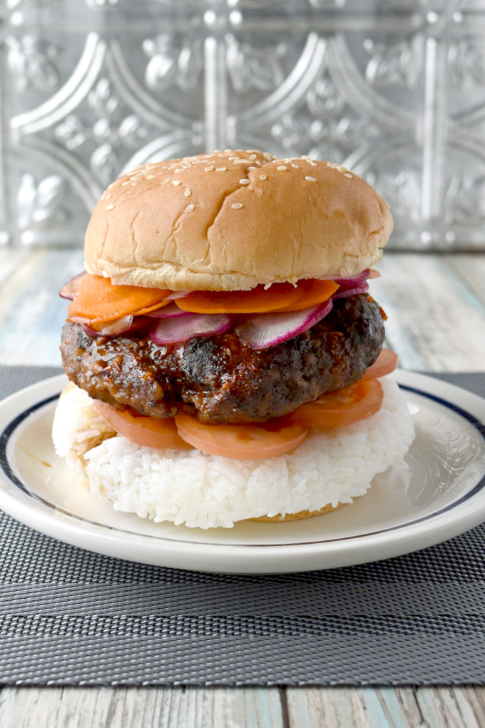Spicy Bulgogi Burger is packed with garlic and ginger flavor, spicy Asian sauce, and topped with thinly sliced carrots and radishes.  It's a flavor and texture packed yum on a bun! #BurgerMonth