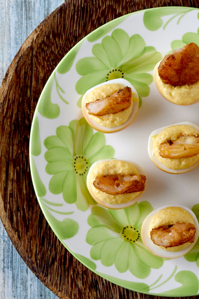 Smoked Chipotle Shrimp Deviled Eggs have smoked chipotle dusted shrimp and smoked eggs combined with mayonnaise and a delicious barbecue mustard sauce.  These will FLY off the table at your next backyard barbecue. #BBQWeek
