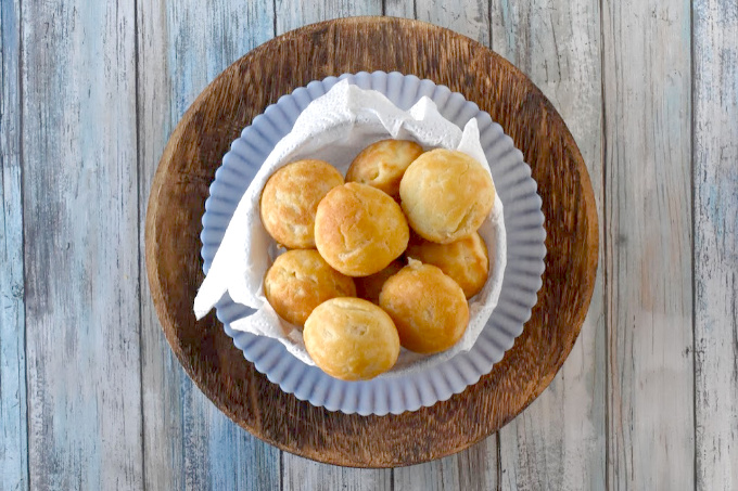 Biscuit Ebelskiver are surprisingly simple to make but taste perfectly delicious.  They're popable bites of buttery goodness that is tender inside and crispy outside.