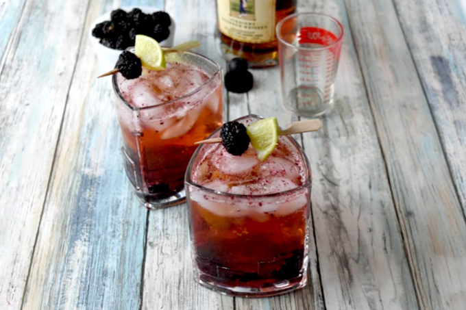 Blackberries and limes are muddle together then topped with craft bourbon and ginger beer in this Blackberry Bourbon Mule. The tart lime and tasty berries compliment the smoky rich flavor of the bourbon. #BerryWeek