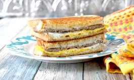 Instead of using a toaster, the bread in this Breakfast Grilled Cheese is buttered and toasted in the pan with the egg, sausage, and cheese all melted together.