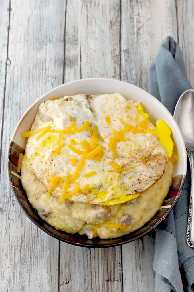 Sausage Egg and Cheese Grits turns this southern breakfast staple into a whole meal on it's own.  This could easily turn into a grits bar with cheese and meat choices for your guests.