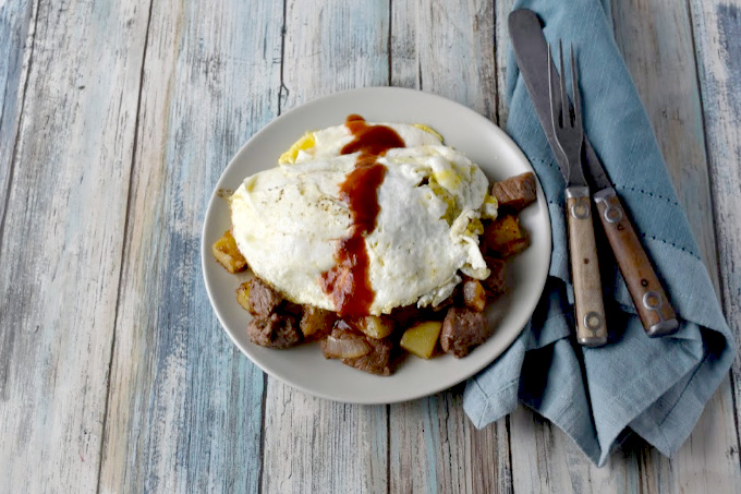 Steak and Potato Hash takes steak and eggs to a whole new level!  Kicked up with steak seasoning and a drizzle of steak sauce, it's a hearty breakfast everyone will love. #BrunchWeek