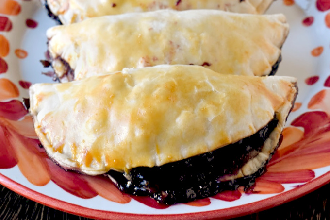 With only six ingredients, Blueberry Hand Pies are simple and simply delicious!  With a hint of ginger, these hand pies are packed with flavor. #SummerDessertWeek