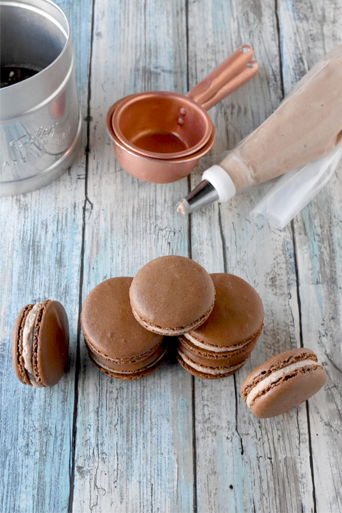 Brownie Batter Macaron have cocoa powder in the shells and brownie batter in the buttercream filling.  They're rich, chocolate, and oh so delicious. #SummerDessertWeek