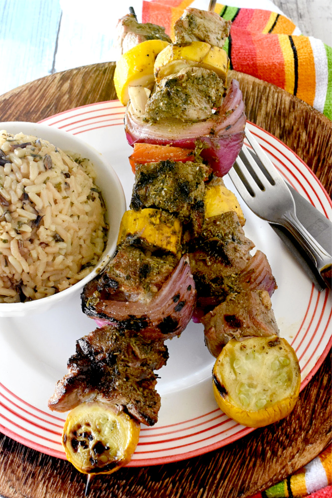 Greek Steak and Veggie Kabobs are packed with flavors but super simple to prepare.  The steak is marinated in Greek spices, olive oil, and balsamic for added flavor. #OurFamilyTable