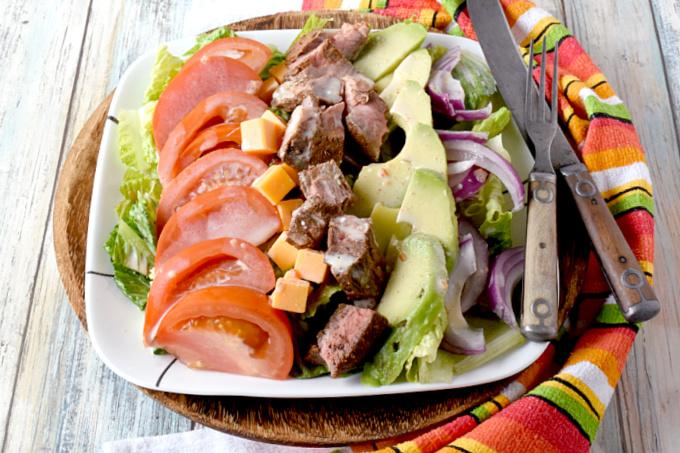 Blackened Steak Cobb Salad has a bit of spice and heat on top of crisp greens with onions, tomatoes, avocadoes, cheese, and hard-boiled eggs.  It's a hearty dinner salad that is quick and easy to make. #FarmersMarketWeek