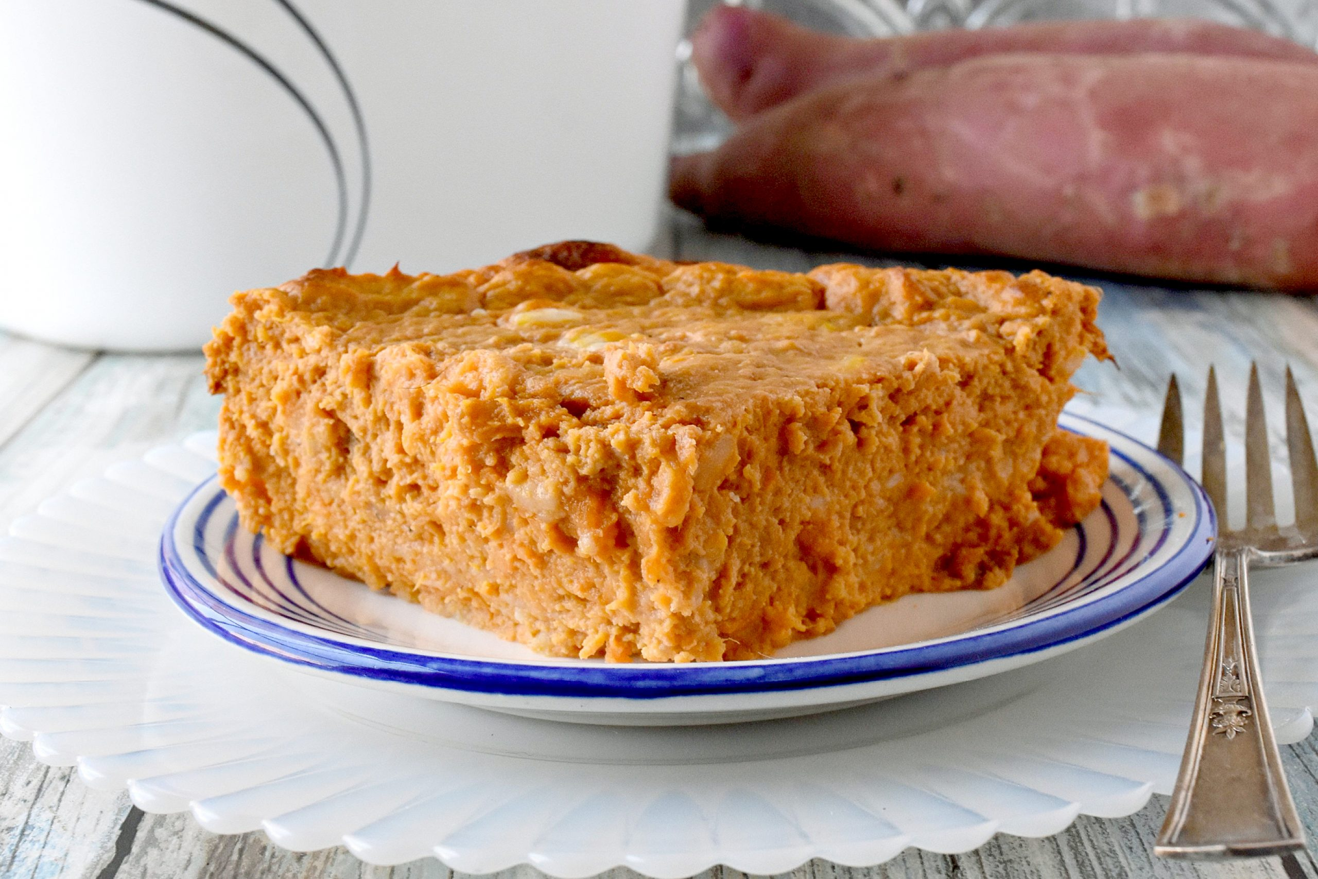 Easy Yam Souffle is not your typical yam souffle. It's savory with delicious Gruyere cheese, eggs, and sage. #FallFlavors