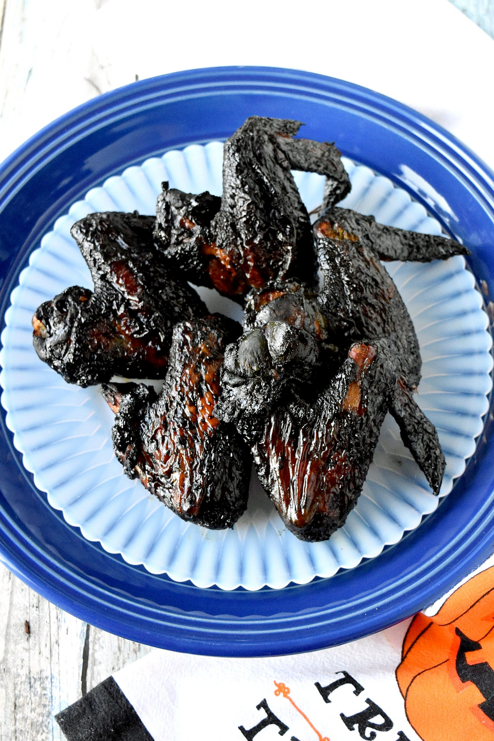 Air Fried Bat Wings look creepy but taste delicious!  Marinated in an Asian inspired sauce, they're crispy and perfectly delicious for your Halloween party. #HalloweenTreatsWeek