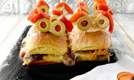 Mini Monster Meatball Sliders are not only fun to make, but fun to eat! Packed with meatballs, cheese, and sauce, these sliders are on the table in no time. #HalloweenTreatsWeek