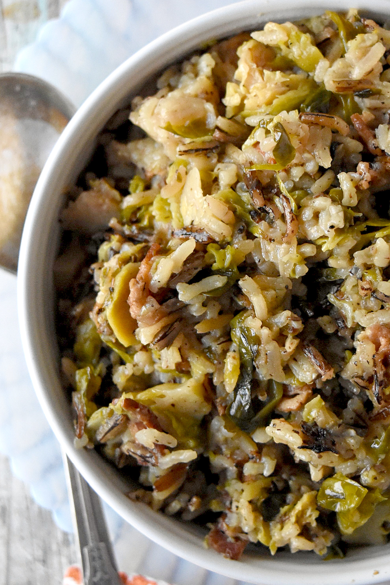 Wild Rice and Sprouts Pilaf is the perfect side dish to any holiday meal.  Any meal for that matter.  With long grain and wild rice simmered with Brussels sprouts and thick cut bacon, it's a side dish you're family will love! #HolidaySideDishes
