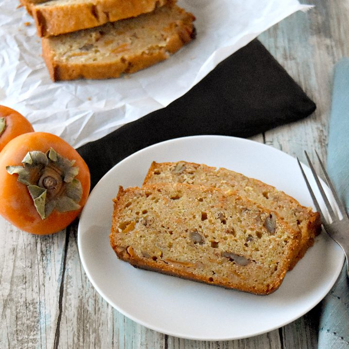 Bourbon Pecan Persimmon Bread has a hint of bourbon and persimmon packed with crunchy pecans. It's moist, delicious, and packed full of deliciously ripe persimmons. #FamilyBakingChallenge #OurFamilyTable