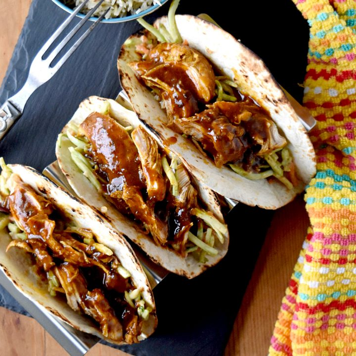 Chicken Tikki Masala Tacos taste amazing for a meal made in under 30 minutes. The chicken simmers in delicious tikki masala sauce and the slaw has extra crunch from the broccoli and peanuts. #eatcleanlivehappy #kevinsnaturalfoods #kevinsrecipechallenge