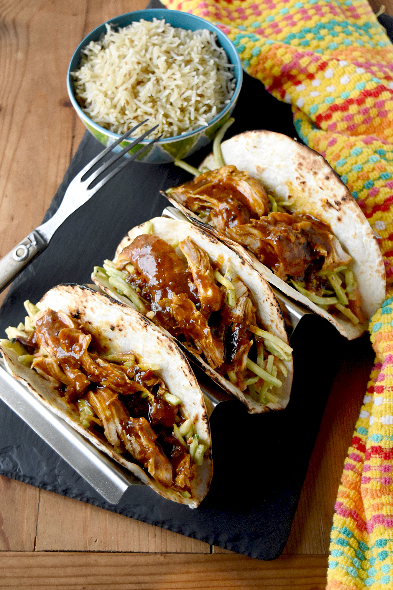 Chicken Tikka Masala Tacos taste amazing for a meal made in under 30 minutes. The chicken simmers in delicious tikka masala sauce and the slaw has extra crunch from the broccoli and peanuts.  #eatcleanlivehappy #kevinsnaturalfoods #kevinsrecipechallenge