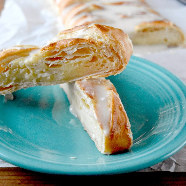 Eggnog Cream Cheese Danish comes together in no time and feeds the hungry masses until the presents are opened. With a hint of eggnog in the filling and eggnog glaze on top, it's the holidays wrapped in puff pastry. #ChristmasSweetsWeek