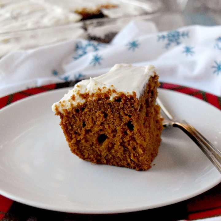 Gingerbread Snack Cake is bite sized but is not small on flavor.  There's fresh ginger, ground ginger, cinnamon, and nutmeg in this delicious, bite-sized snack cake. #ChristmasSweetsWeek