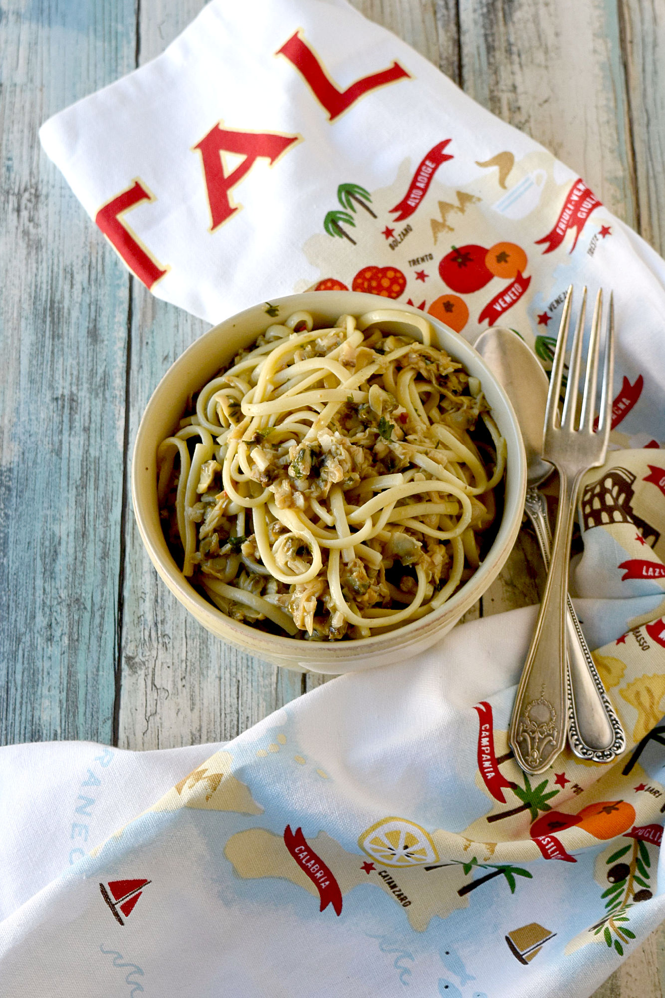 Easy Linguine with Clam Sauce uses pantry ingredients and comes together in a snap! It's perfect for those busy weeknights and even fancy enough for a date dinner! #OurFamilyTable