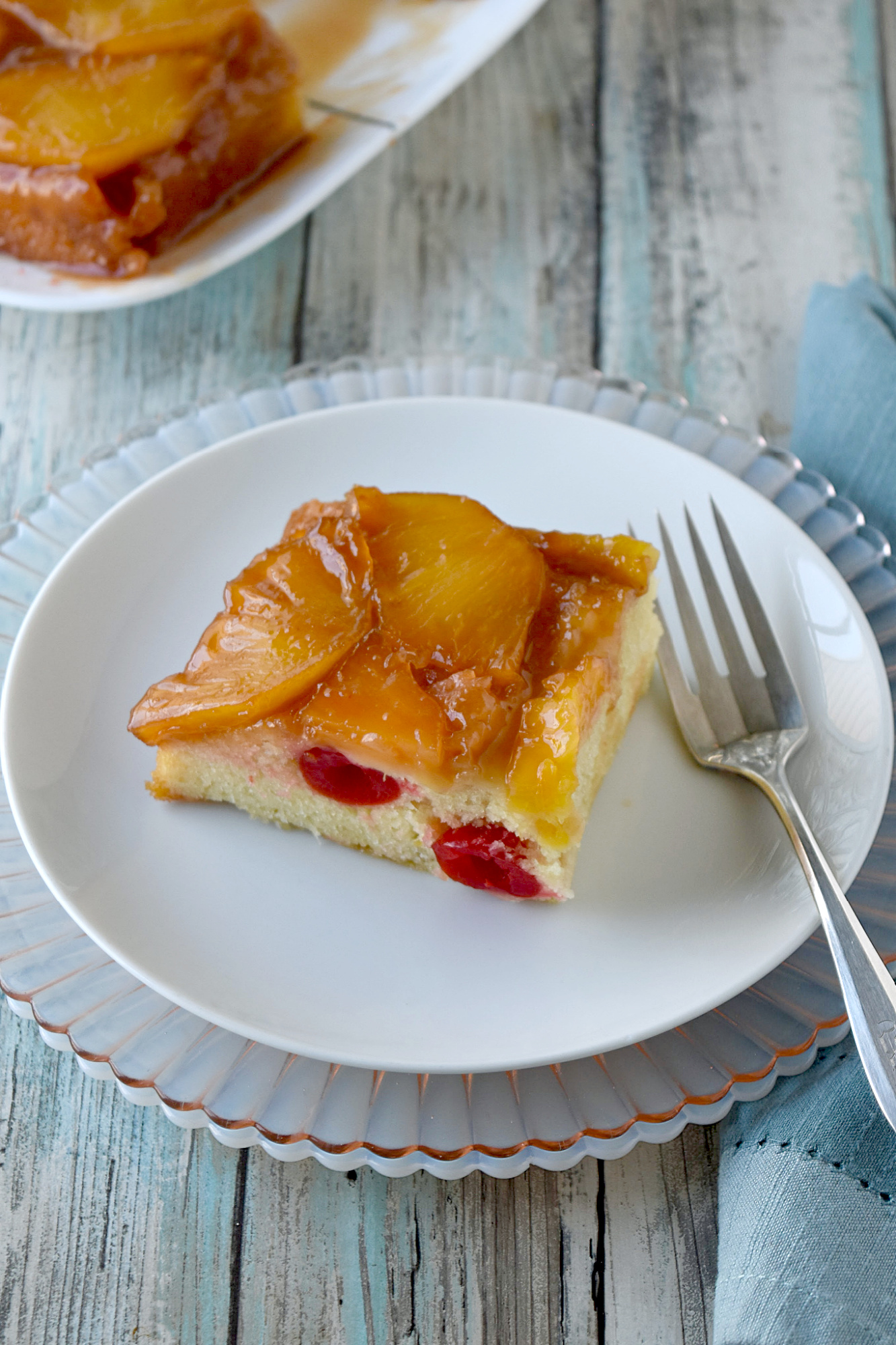 Fresh Pineapple Upside Down Cake has fresh, sweet t on top hand light and moist cake underneath. It's a simple and quick cake that bakes up easily. #SpringSweetsWeek