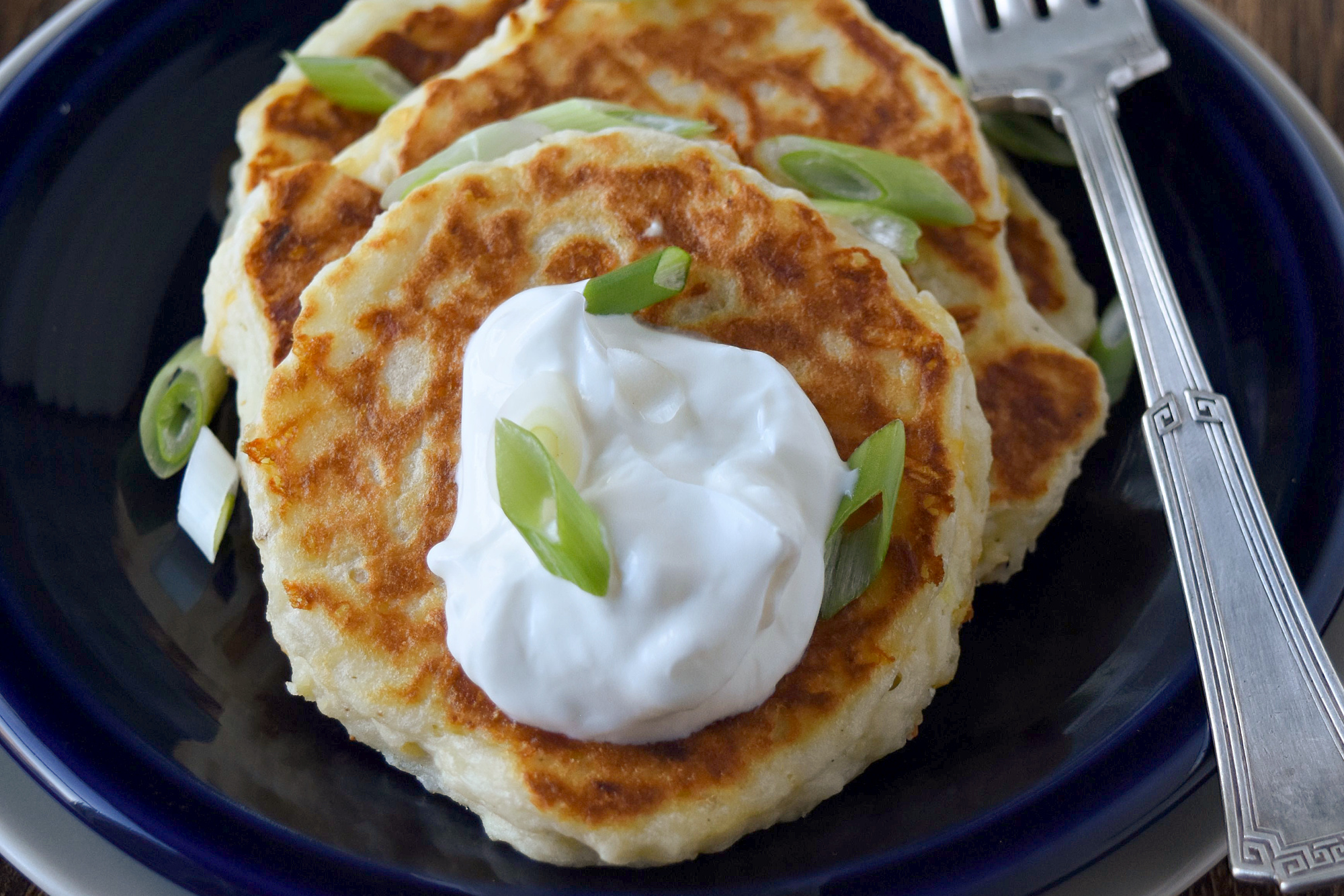 Nana's Potato Pancakes is our family's version of an Americanized boxty. Made with leftover mashed potatoes, they whip up in no time for a delicious and fun side dish or brunch recipe. #OurFamilyTable