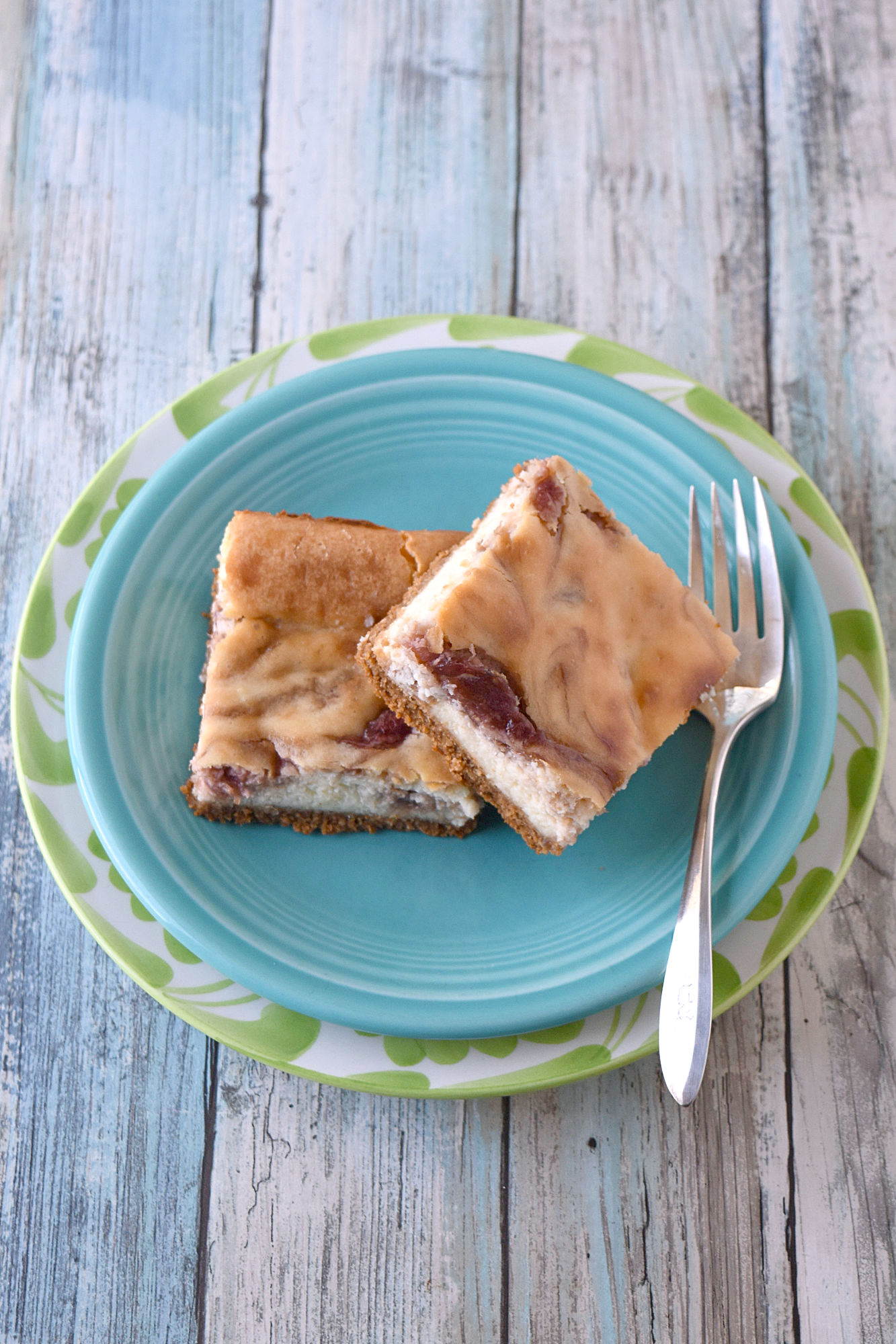 Rhubarb Cheesecake Bars are full of sweet tart flavor. They are creamy and perfectly delicious. #SpringSweetsWeek