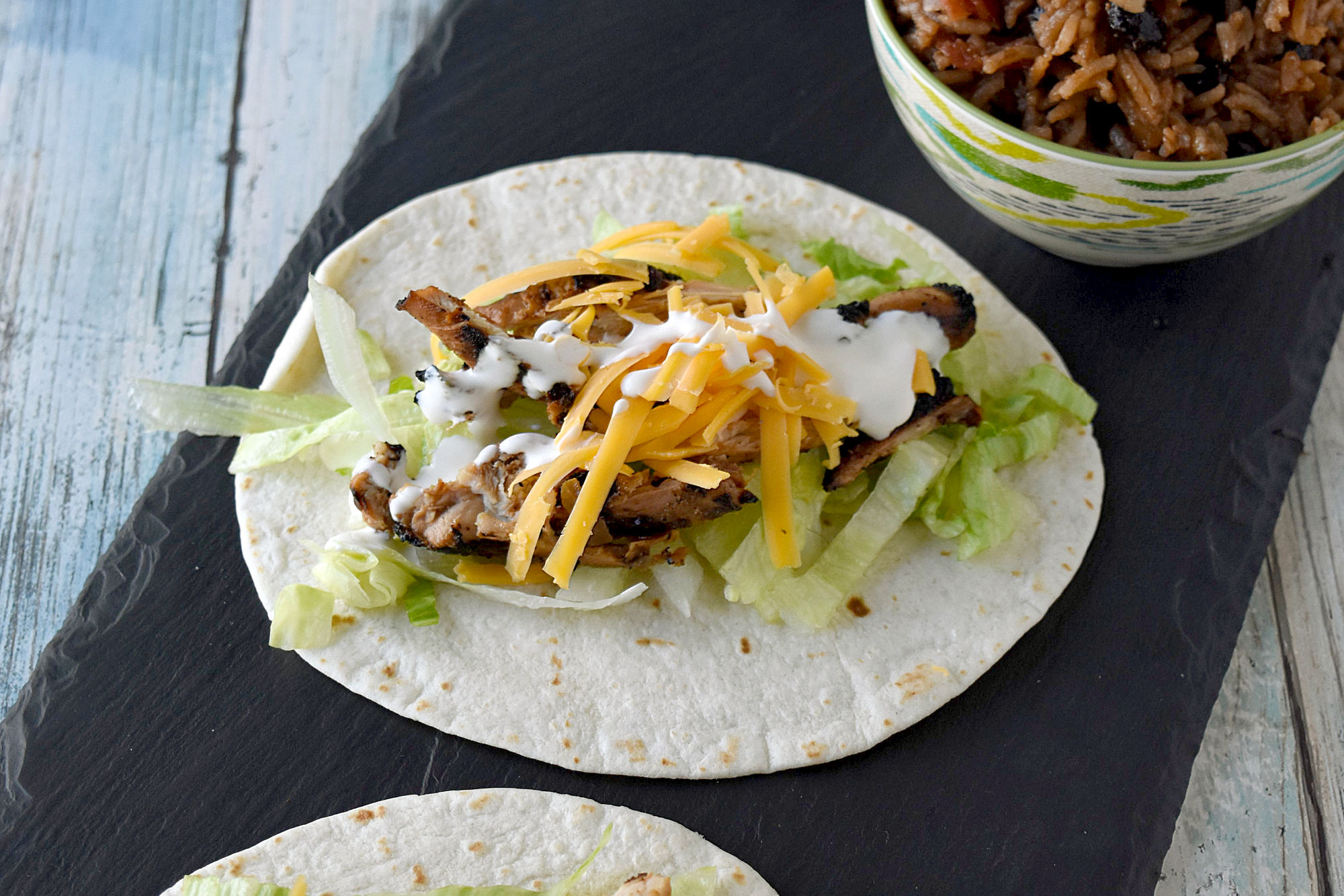 Cuban Marinated Chicken Tacos are marinated with orange and lime juice, cumin, garlic, and minced onion. Boneless, skinless chicken thighs means they grill up quick for any night of the week. #BBQWeek