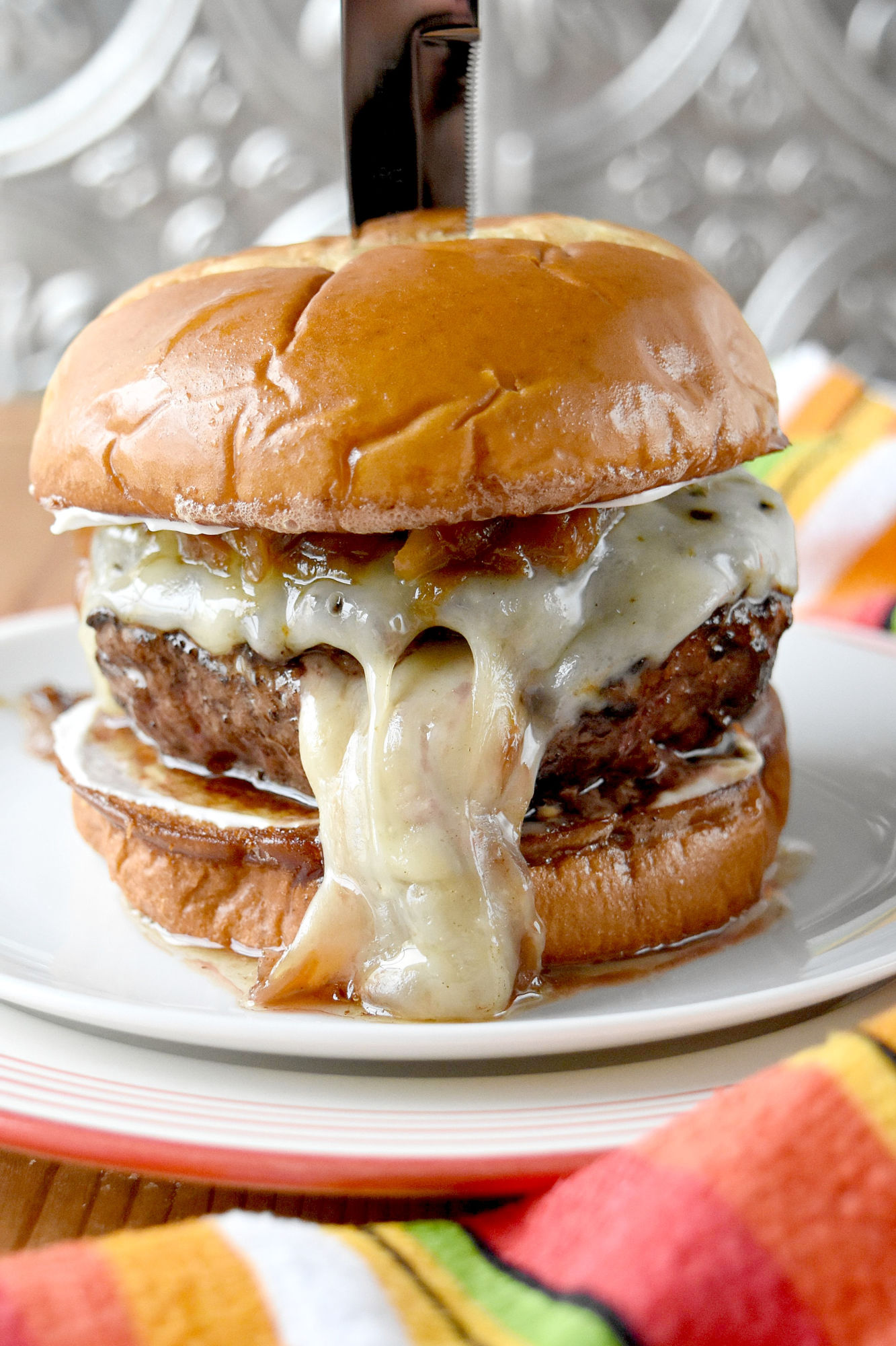 The caramelized onions make this French Onion Soup Burger over the top. It's a labor of love but makes for one killer burger. #BurgerMonth