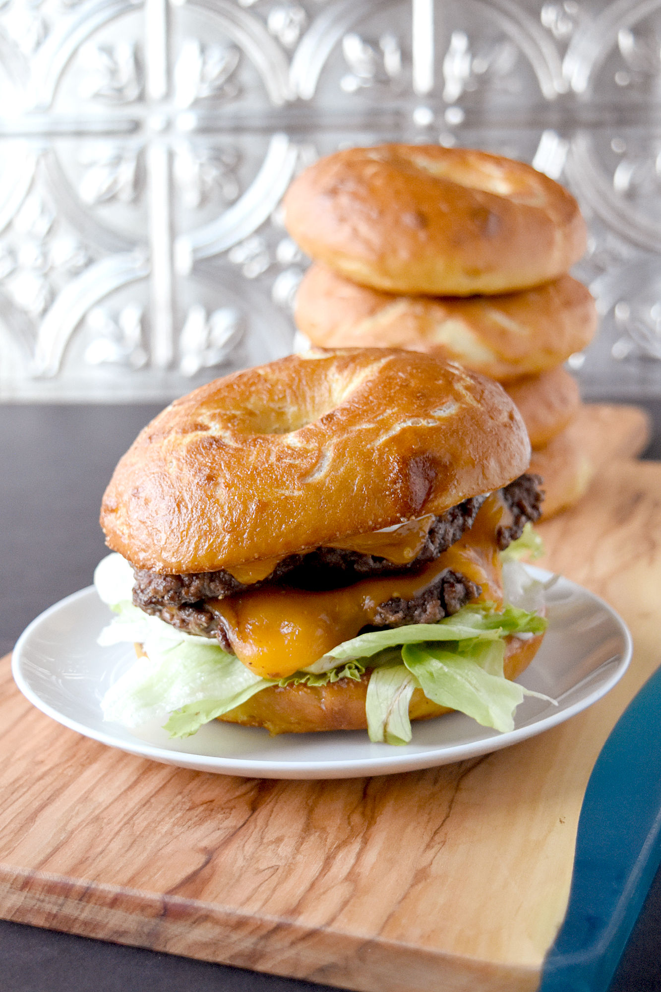 Bagel Buns are deliciously simple to make for any backward grilling party. They stand up to the any burger and taste delicious. #OurFamilyTable